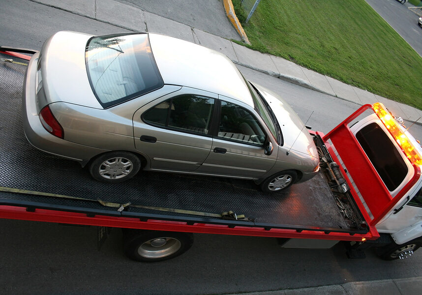This is a picture of a car on a flatbed truck.